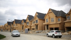 A row of houses under construction are seen at a subdivision near the town of Kleinburg, Ontario
