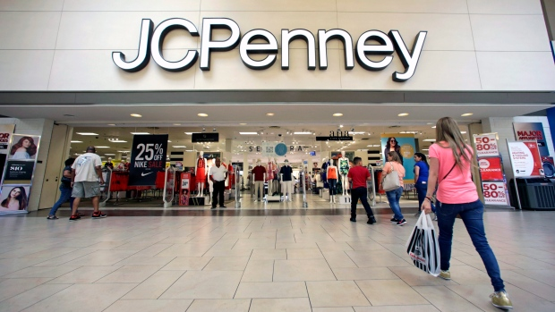 Shoppers walk into a J.C. Penney department store in Hialeah, Fla.