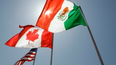 National flags representing the United States, Canada, and Mexico