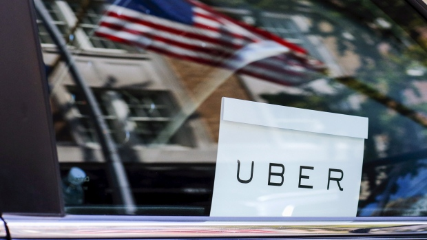 An Uber sign is seen in a car in New York