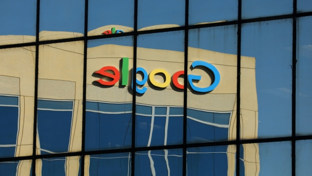 The Google logo is shown reflected on an adjacent office building in Irvine, California, U.S.