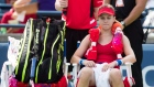 Eugenie Bouchard sits in her chair between games at the Rogers Cup WTA tournament in Toronto
