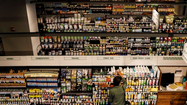 Customers shop at a Whole Foods store in New York City