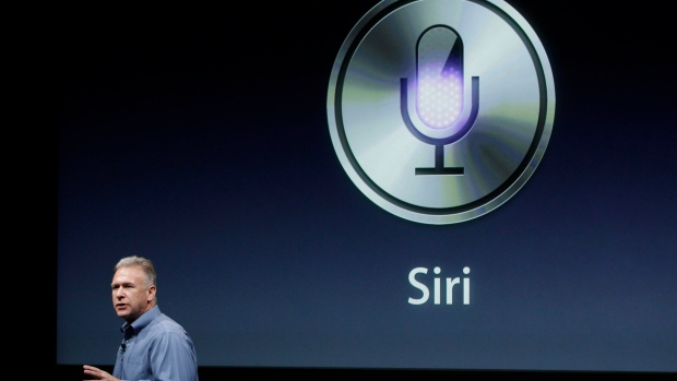 Apple's Phil Schiller talks about Siri during an announcement at Apple headquarters in Cupertino
