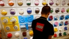 A Lego employee sorts Legos at one of the toy company's stores in Paris, France