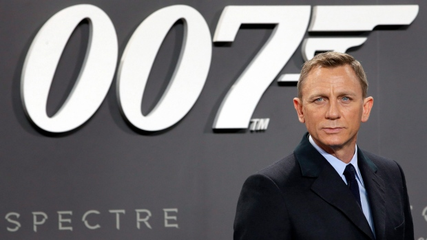 Daniel Craig poses for the media as he arrives for the German premiere of the movie 'Spectre'