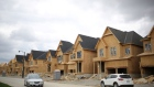 A row of houses under construction are seen at a subdivision near the town of Kleinburg