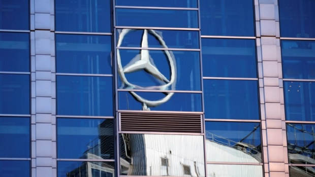 A Mercedes-Benz sign reflected on a building in Warsaw, Poland, July 6, 2017