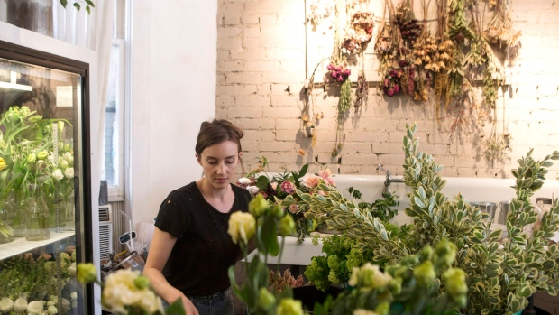 Flowers are arranged at the Coriander Girl florist shop in Toronto