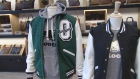 Clothing - including Drake's October's Very Own brand - is displayed at a Roots Canada store