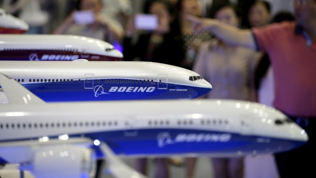 Visitors look at models of Boeing aircrafts at the Aviation Expo China 2015, in Beijing