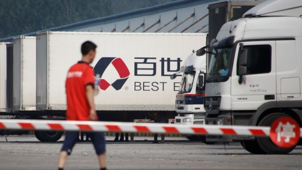 A man walks in the compound of a distribution hub of the Chinese logistics company Best Inc