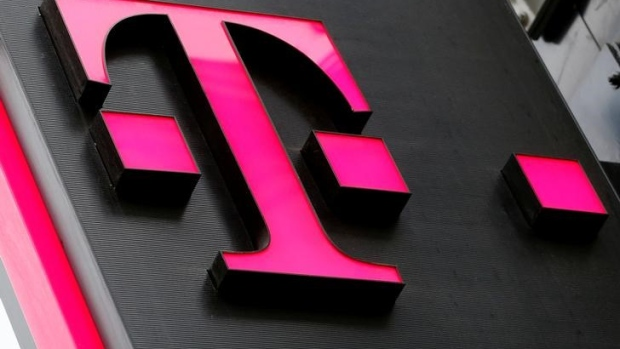 The logo of T-Mobile Austria is seen outside of one of its shops in Vienna