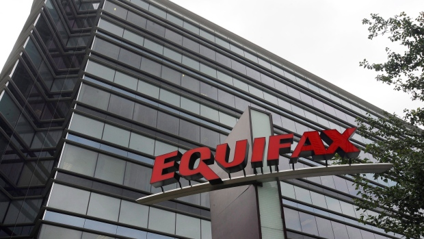 Equifax warns on post-breach costs, revenue hit