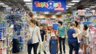 In this Friday, Nov. 25, 2016, file photo, shoppers shop in a Toys R Us store on Black Friday