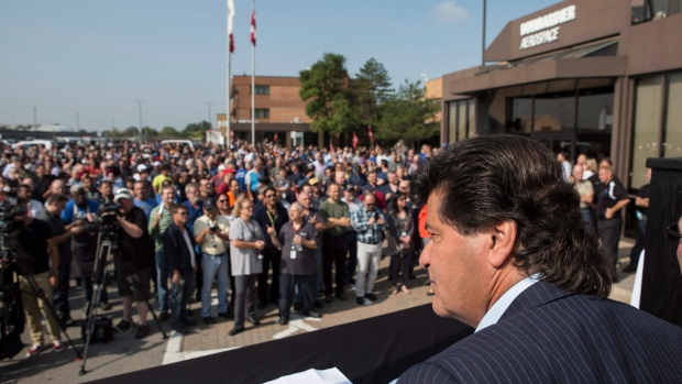 Unifor National President Jerry Dias waits for Bombardier workers to assemble