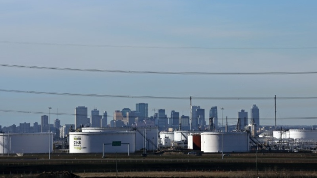 Enbridge's facility in Sherwood Park are seen against the skyline of Edmonton, Alberta
