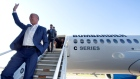 Airbus Chief Executive Tom Enders waves to employees followed by chairman of the board of Bombardier Inc., Pierre Beaudoin after touring a Bombardier CSeries plane at Bombardier's plant in Mirabel