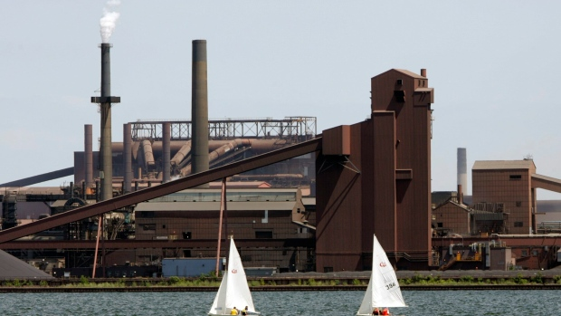 Sailboats make their way past part of the Stelco plant in Hamilton, Ont. Friday July 23, 2004