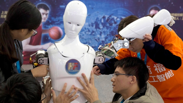 In this Oct. 21, 2016, file photo, Chinese students work on the Ares, a humanoid bipedal robot