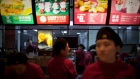 Employees prepare to serve customers at a McDonald's in central Beijing Wednesday, Dec. 15, 2010.