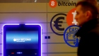 A man walks past a bitcoin ATM in Vilnius, Lithuania December 6, 2017.