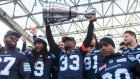 Toronto Argonauts players hold the Grey Cup on Nov 28 2017