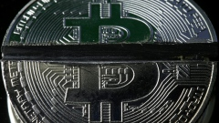 Sawed Bitcoin tokens representing the virtual currency are seen in this illustration picture