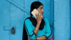 A woman talks on her mobile phone on a pavement in Kolkata, India July 5, 2017