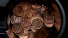 A handful of one cent coins is seen in a passenger car cupholder in Dartmouth, N.S.