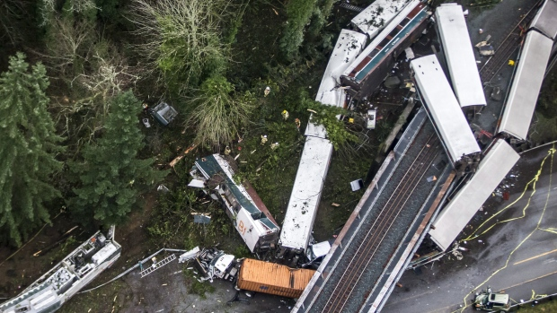 Cars from an Amtrak train that derailed above lie spilled onto Interstate 5, Monday, Dec. 18, 2017,