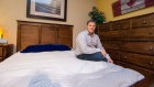 Mike Cleaver poses with a new waterbed at his mattress store in Barrie, Ont., Dec. 21, 2017