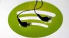 Earphones are seen on a tablet screen with a Spotify logo on it, in Zenica, Bosnia and Herzegovina