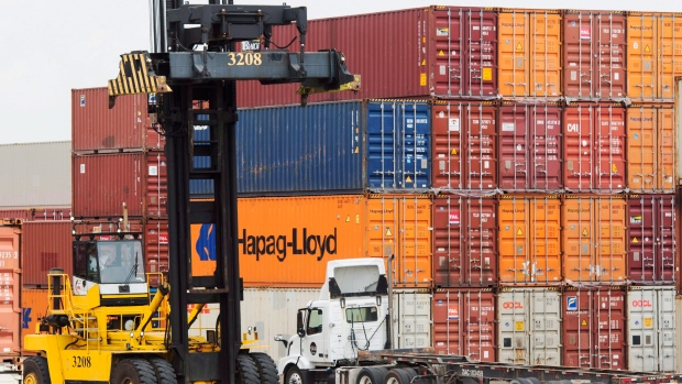 Containers are unloaded at the Port of Montreal Thursday, July 20, 2017 in Montreal