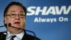 Shaw Communications Chief Executive Officer Jim Shaw speaks in 2004