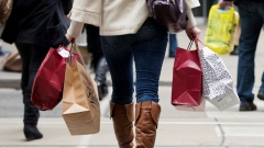 A woman carries shopping bags during the Christmas shopping season in Toronto, December 7, 2012