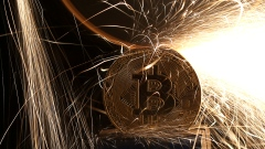 Sparks glow from broken bitcoin coins in this illustration picture, December 8, 2017