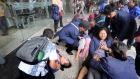 Injured persons are evacuated from the Jakarta Stock Exchange tower in Jakarta, Indonesia.