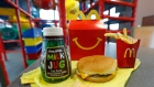 A Happy Meal featuring non-fat chocolate milk and a cheeseburger with fries